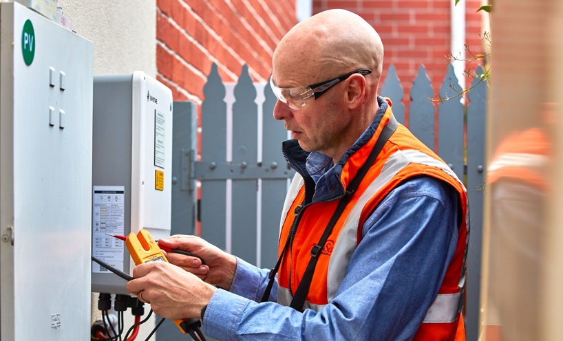Worker monitoring energy use at a home
