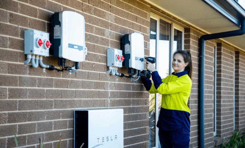 Solar worker installing solar battery