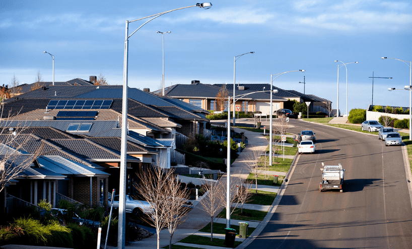 Street with houses with solar panels installed