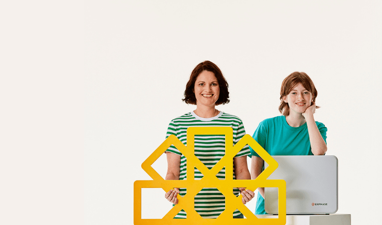 Family holding solar battery and yellow cardboard sun
