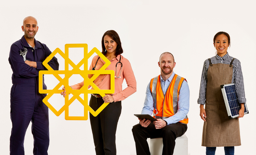 Four people from different professions holding a yellow cardboard sun