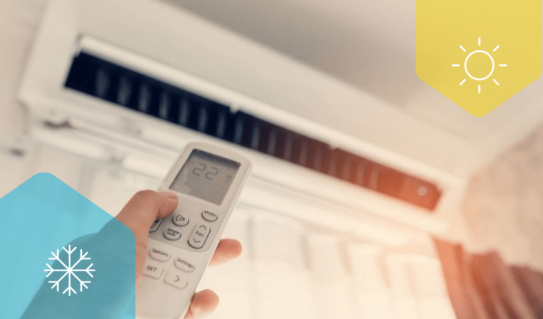 A remote pointing at a split system air conditioner